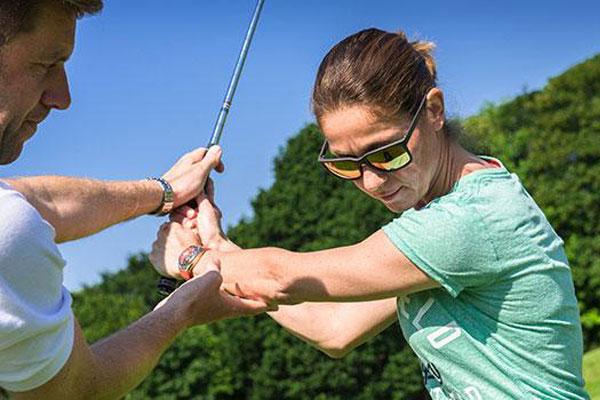 Woman golf swing lesson