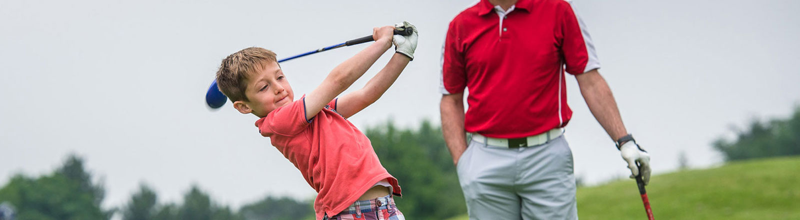 Golf boy swing in pink top
